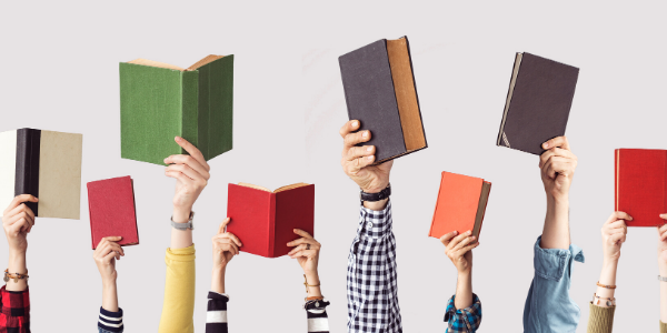 Children Holding Up Books in Their Hands
