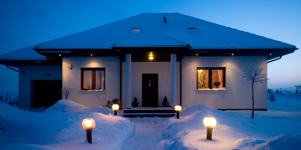 House in Winter with Snowfall