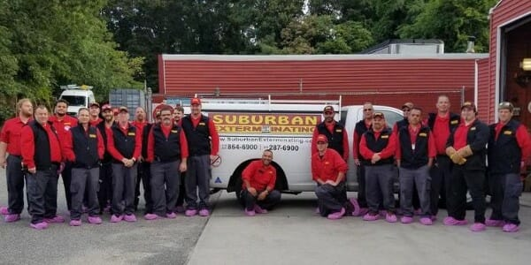 Suburban Exterminating Team in Pink Breast Cancer Shoe Covers